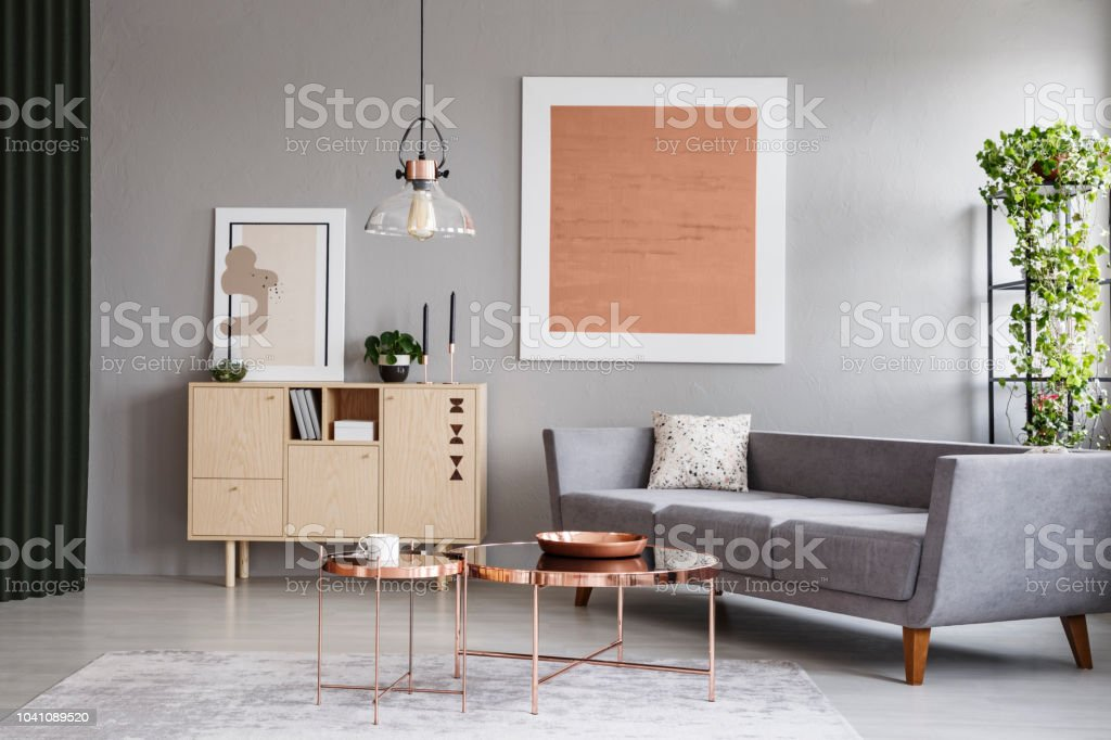 modern gray living room pinterest small couch and copper tables in a grey interior with painting real