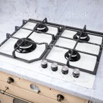 Modern Hob Gas Stove Made Of Tempered White Glass Using Natural Gas Or Propane For Cooking Products On Light Countertop In Kitchen Interior Stock Photo Download Image Now Istock