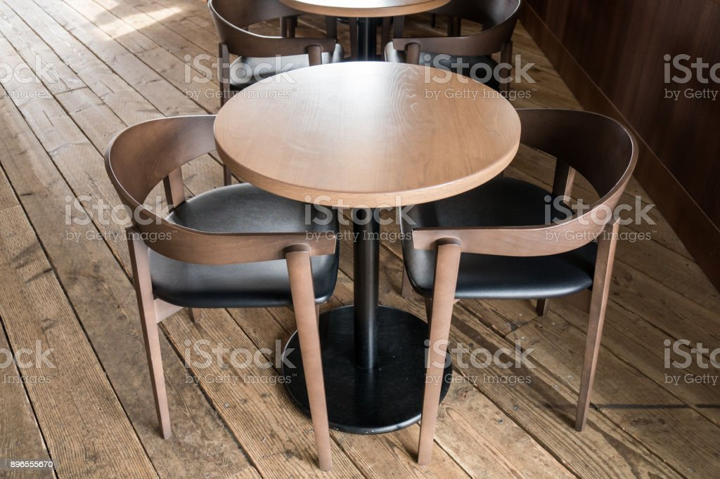 Modern Wooden Table And Chair In Coffee Shop Stock Photo Download Image Now Istock