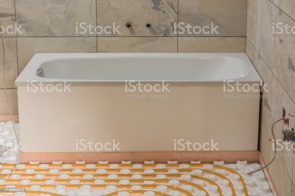 Modernization Of The Bathroom With New Tub Tiles And Underfloor Heating Stock Photo Download Image Now Istock