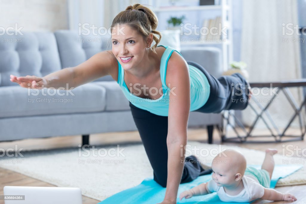 Mom And Baby Exercise Together At Home Stock Photo ...