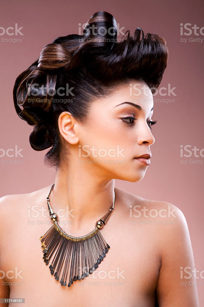Nude Women Wearing A Necklace And Hair Tied Up stock photo