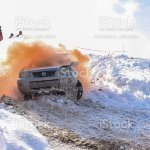 Off Road Crossover Nissan Xtrail 4x4 Quickly Leaves The Clouds Of Orange Smoke Against The Background Of People In The Sunny Fog In Winter Stock Photo Download Image Now Istock
