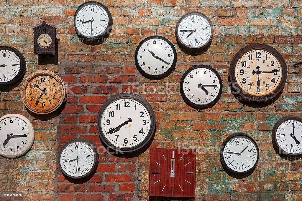 old clocks on brick