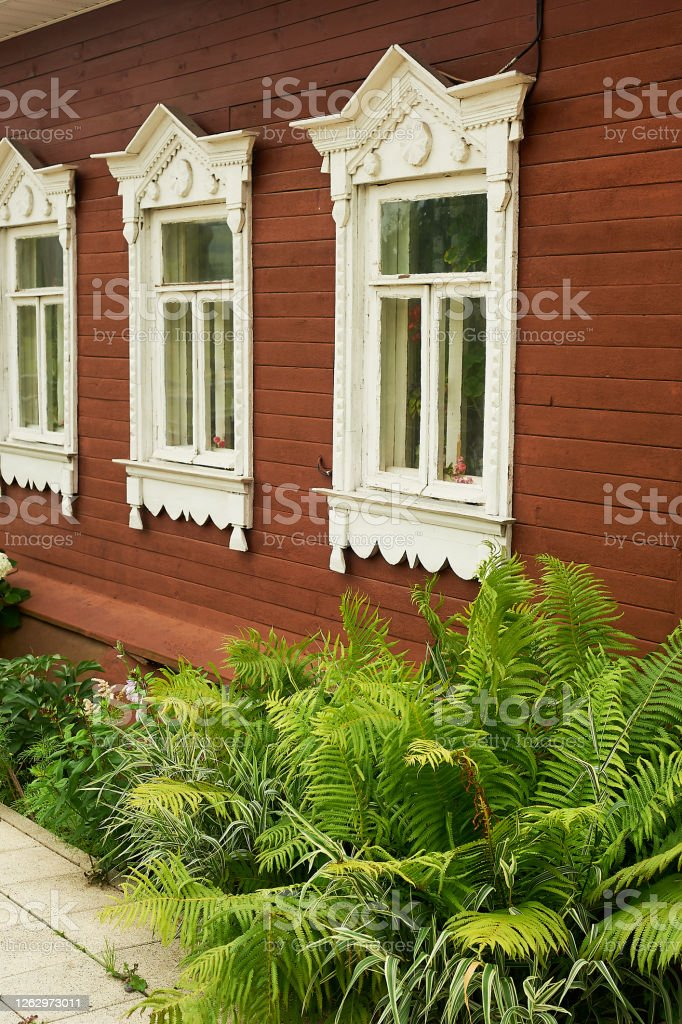 old wooden houses with beautiful windowsframes with tilesan old russian house stock photo download image now istock