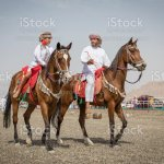Omani Father And Son Riding Horses Stock Photo Download Image Now Istock