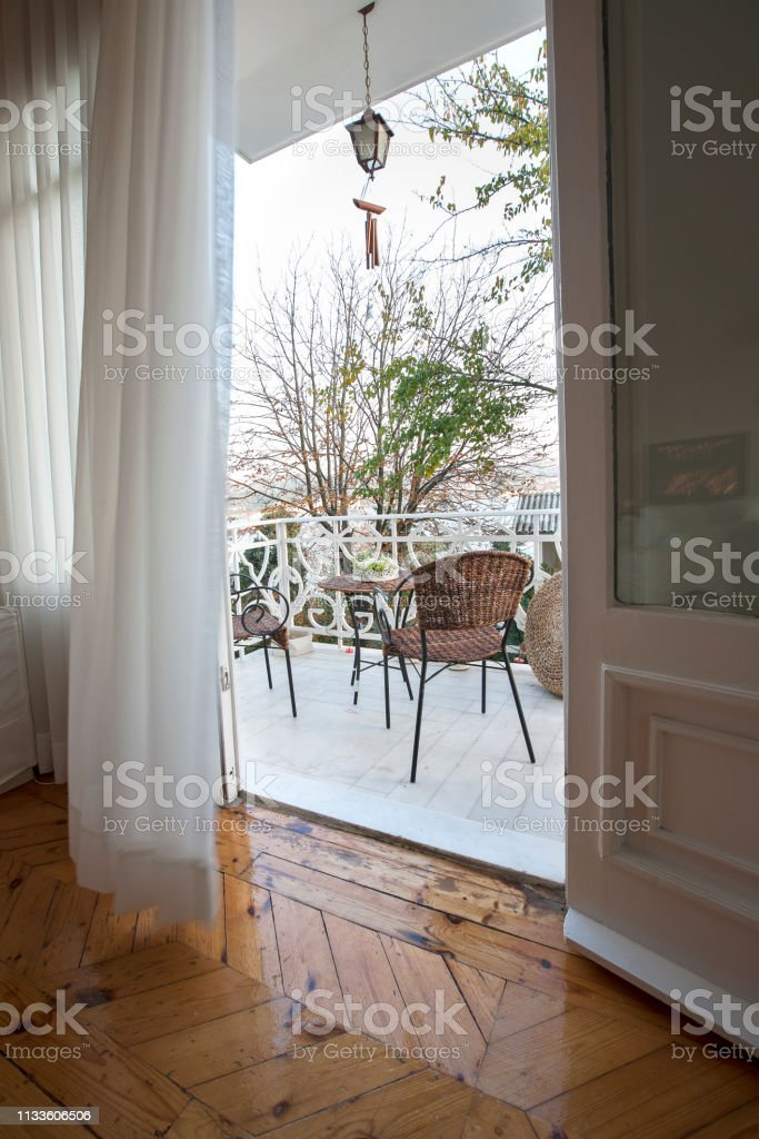 open door with transparent white curtains drapery with view on terrace tranquil scene stock photo download image now istock