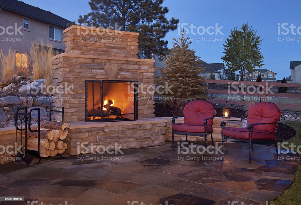 https www istockphoto com photo outdoor flagstone platform with fireplace chairs gm153816520 19302451
