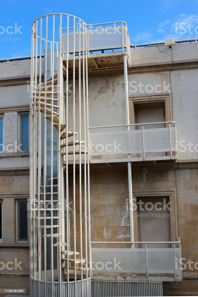 Outdoor Spiral Stairs Fire Escape On A Building Stock Photo | Outdoor Spiral Staircase Near Me | Staircase Ideas | Staircase Kits | Balcony Railing | Oak70 Xtra | Wrought Iron