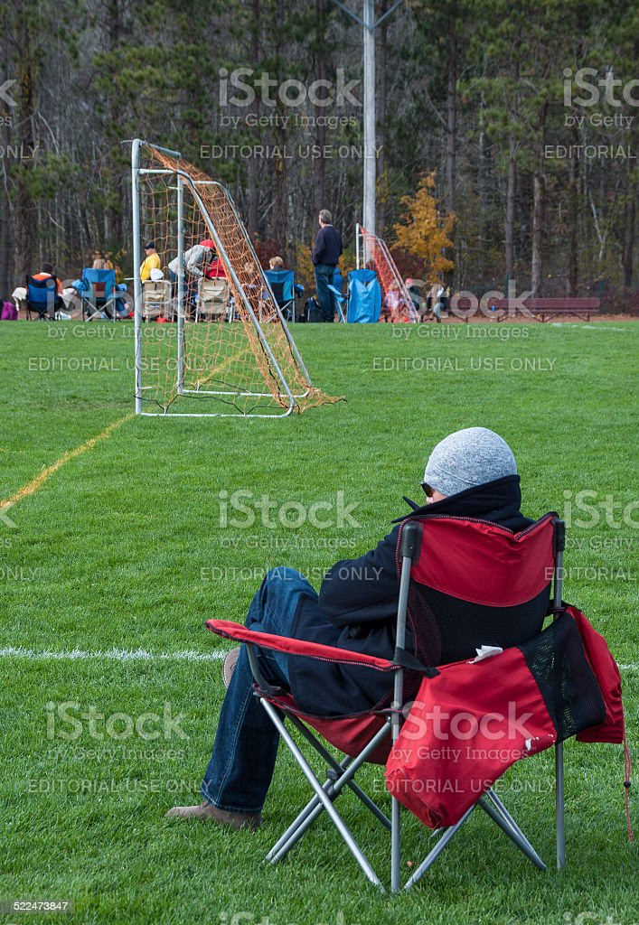 soccer mom covered chairs wicker lounge sale royalty free pictures images and stock photos istock parent watches youth photo