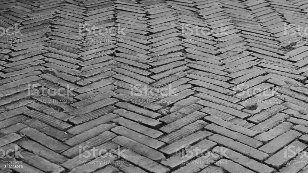 patterned old paving tiles black and white brick floor background stock photo download image now istock