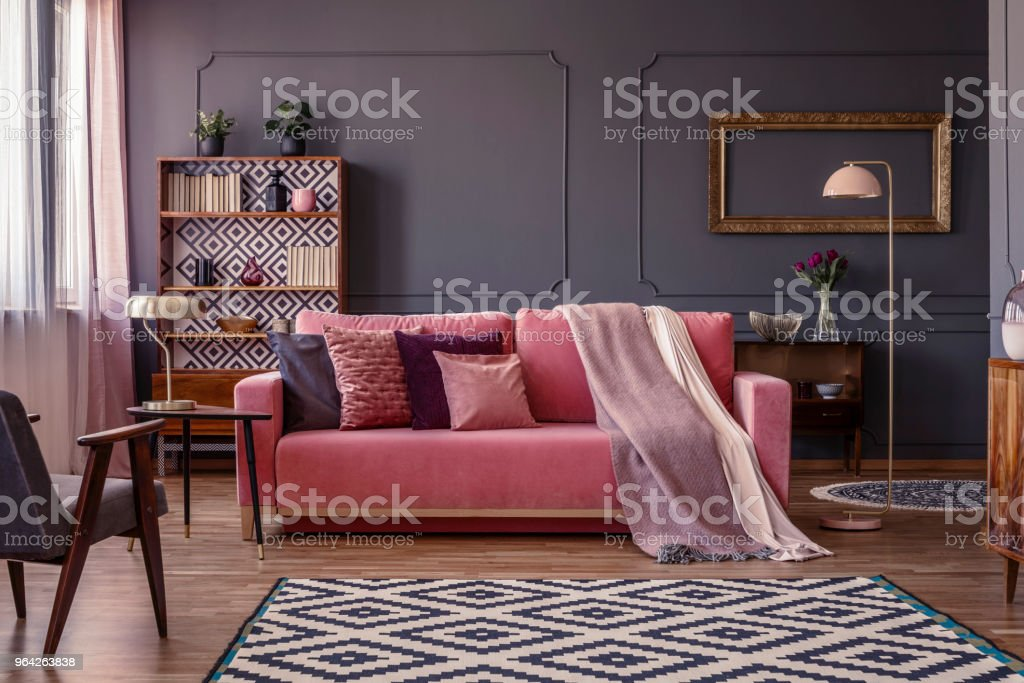 dark grey living room carpet wall paint ideas pink velvet lounge with cushions and blanket standing in the middle of