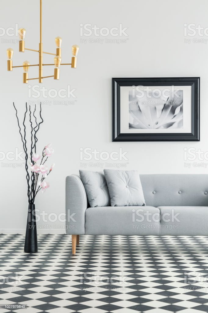 living room clocks next modern ideas uk plant to grey couch in interior with checkered floor and poster real photo stock image