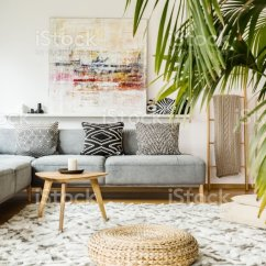 Living Room Pouf Cream Furniture For The And Wooden Table In Modern With Painting Above Grey Corner Couch Real
