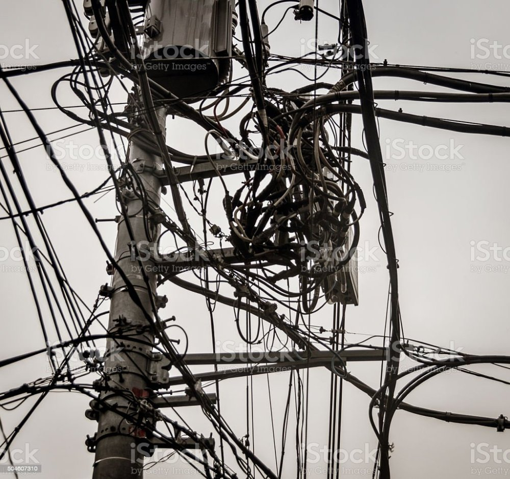 medium resolution of power line and telephone line mess stock image