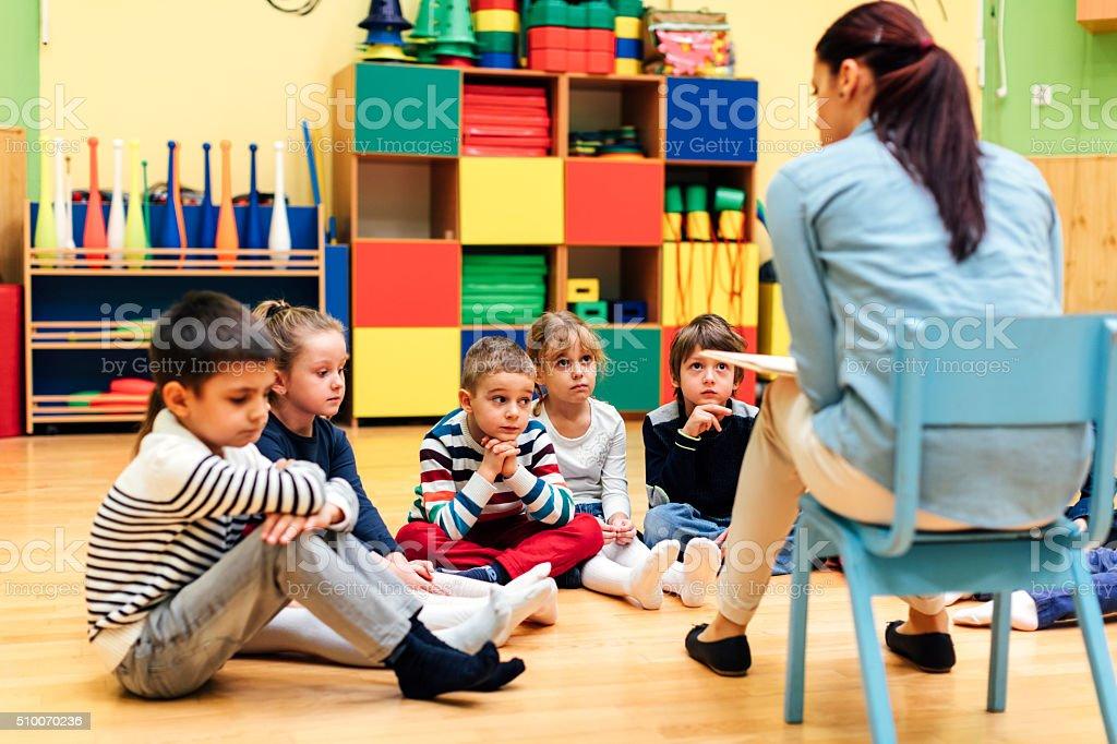 Preschool Teacher And Children In Classroom Stock Photo - Download Image Now - iStock