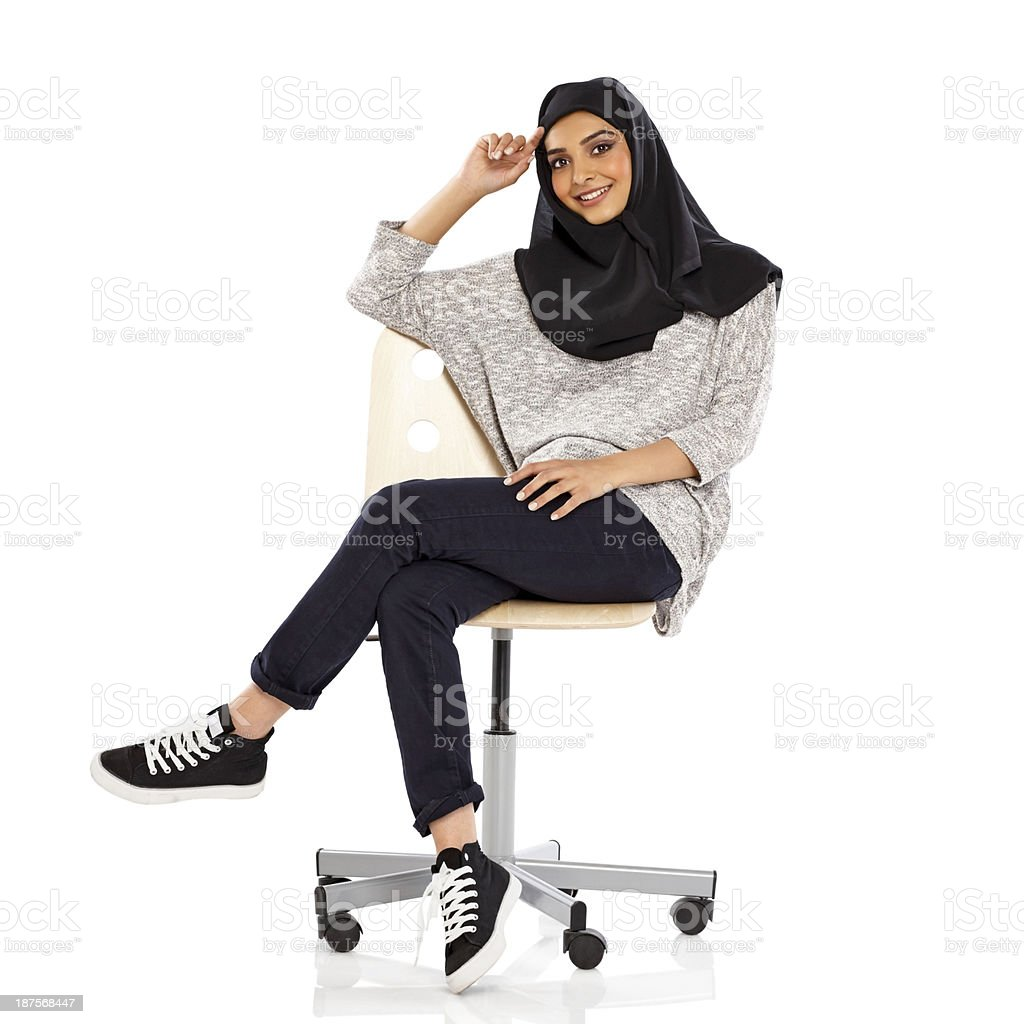 woman sitting in chair walmart rolling pretty young muslim on office stock
