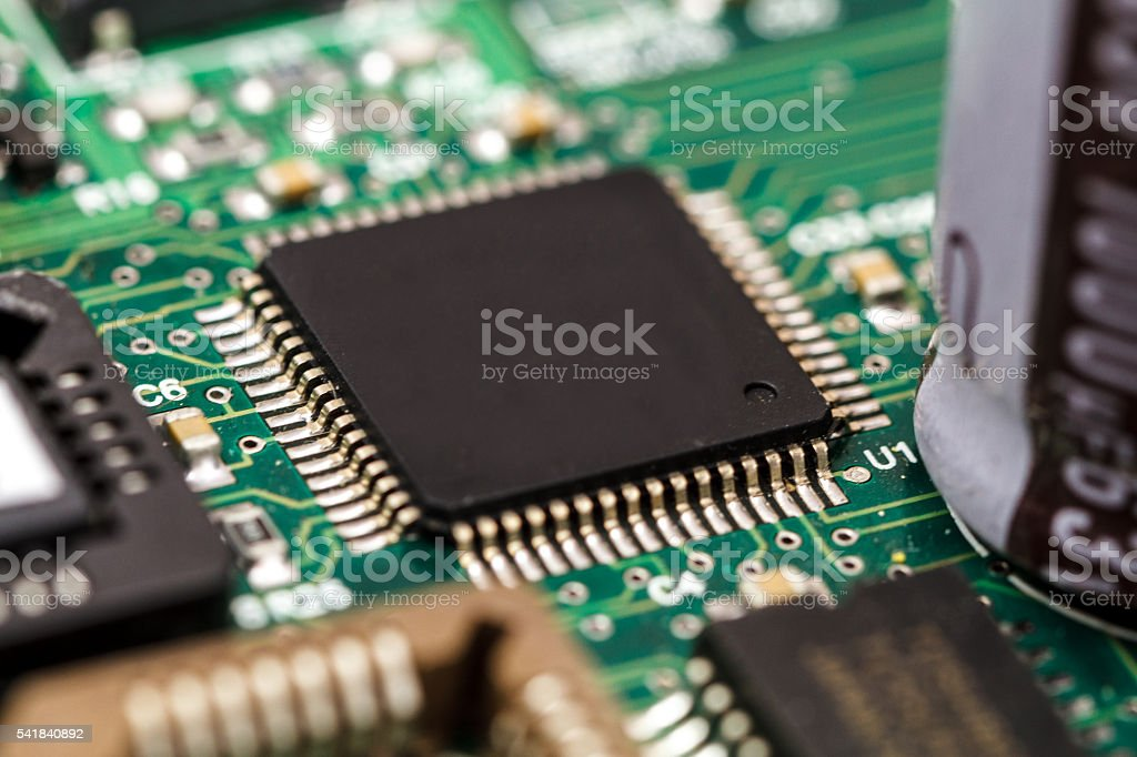 Circuit Board Featuring A Microchip And Resistors Stock Photo