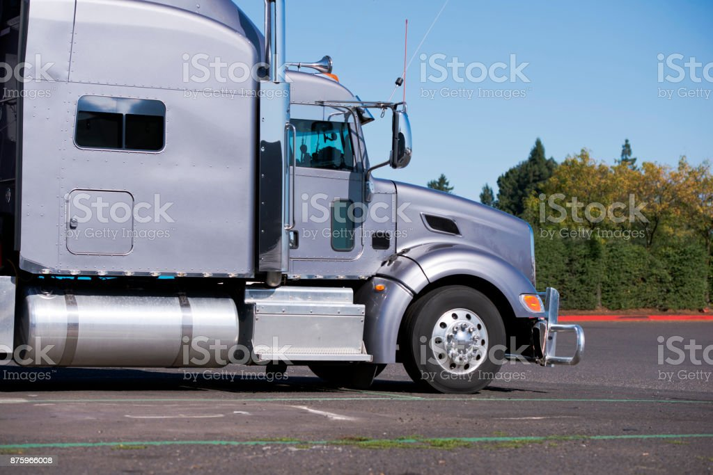 profile of big rig gray classic semi truck tractor going to delivery commercial cargo stock photo download image now istock