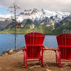 Red Adirondack Chairs Spanish Colonial Dining At Lake Minnewanka In Banff National Park Stock Image