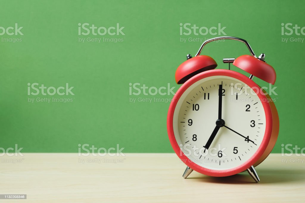 red vintage alarm clocks