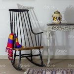 Rocking Chair And Old Style Vintage Table On Background Of
