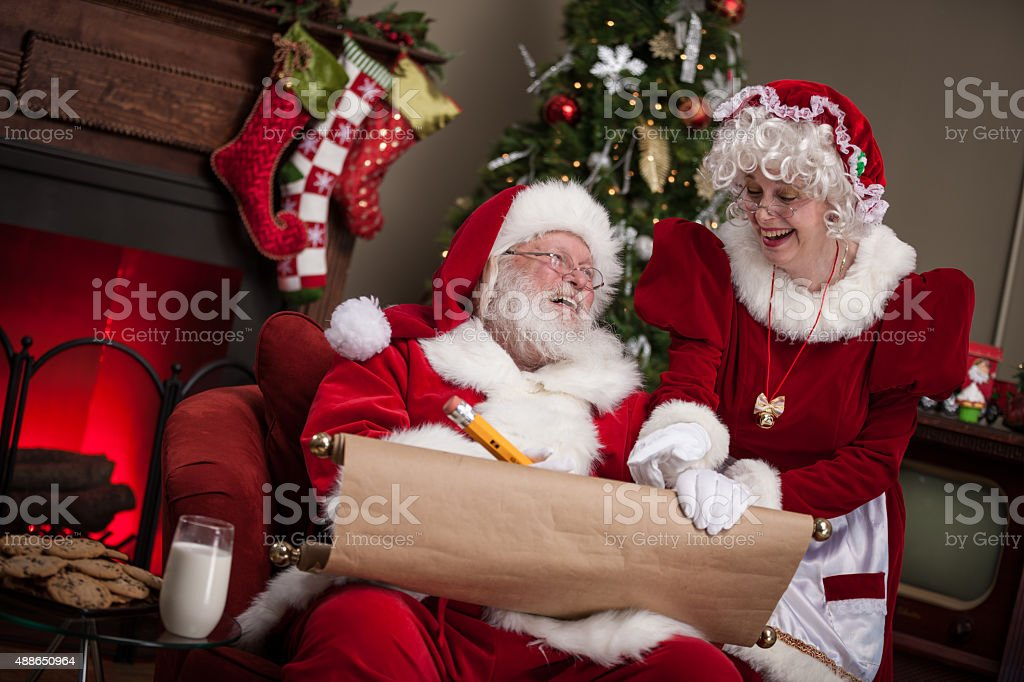 Santa Claus And Wife Working On Naughty And Nice List
