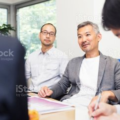 What Is A Chairperson In Meeting Chairs For Posture Support Senior Giving His Opinion Stock Photo Royalty Free