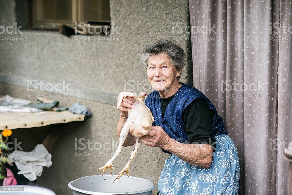 Best Women Killing Chicken Stock Photos Pictures ...