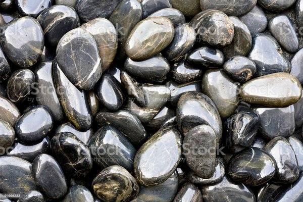 shiny smooth river rocks stock