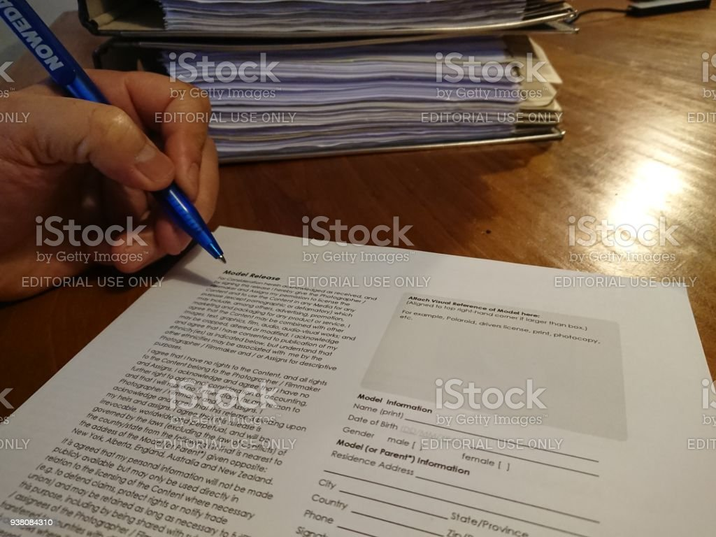 Signing A Model Release Form Stock Photo & More Pictures of Adult ...