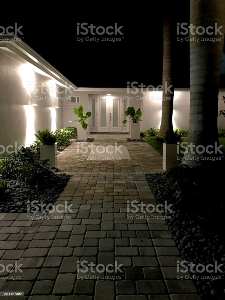 singlestory contemporary tropical house at night stock photo download image now istock