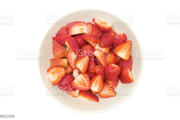 Sliced Strawberries In A Bowl Stock Photo More Pictures