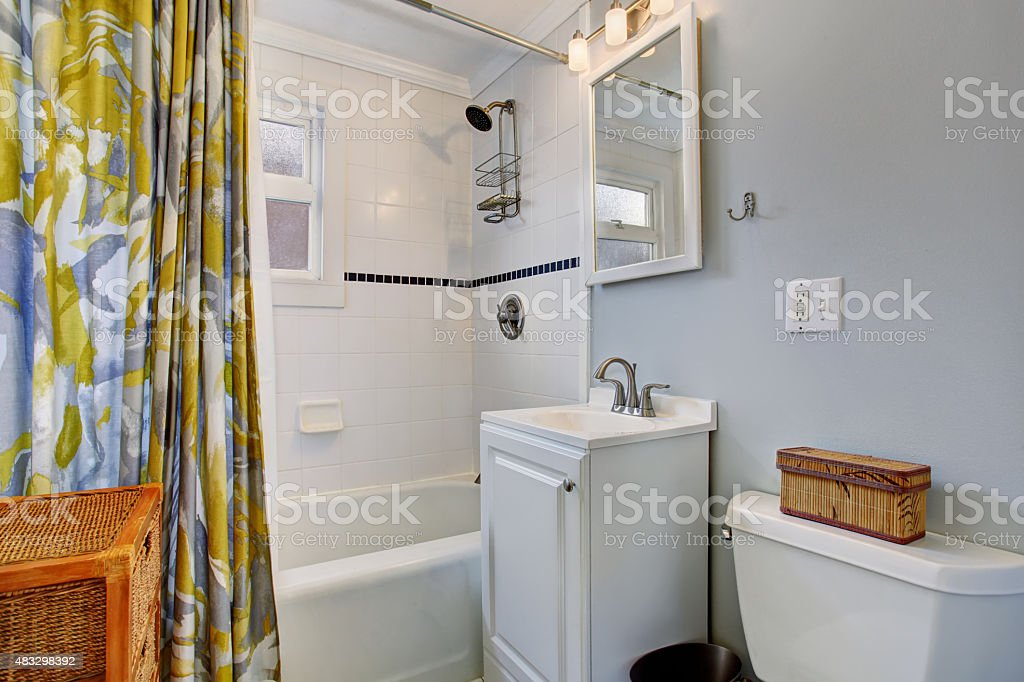 https www istockphoto com photo small bathroom with blue walls and colorful shower curtain gm483298392 70558205
