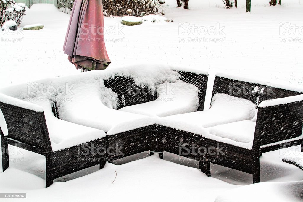 https www istockphoto com photo snowstorm leaves heavy amounts of snow on outdoor patio furniture gm1094676640 293810617