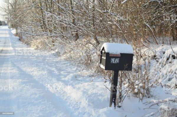 snowy rural winter road mailbox