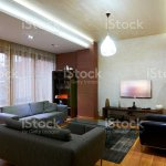 A Spacious Apartment Room With Black Sofas Stock Photo Download Image Now Istock