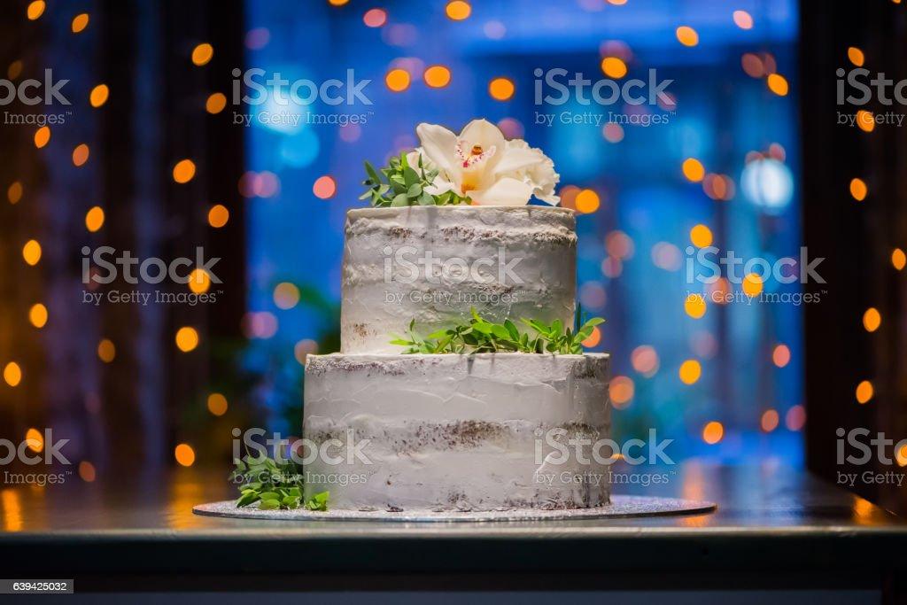 Splitlevel Wedding Cake With Natural Flowers On Bokeh