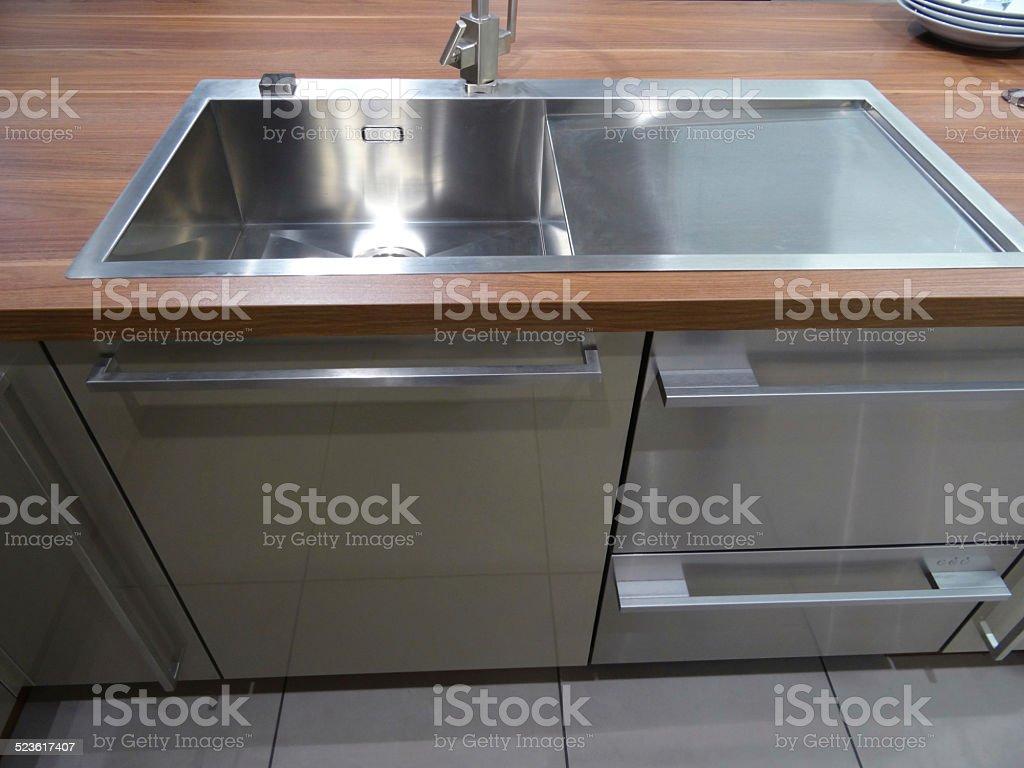 https www istockphoto com photo stainless steel kitchen sink single basin real walnut dark wood worktop counter top gm523617407 51673636