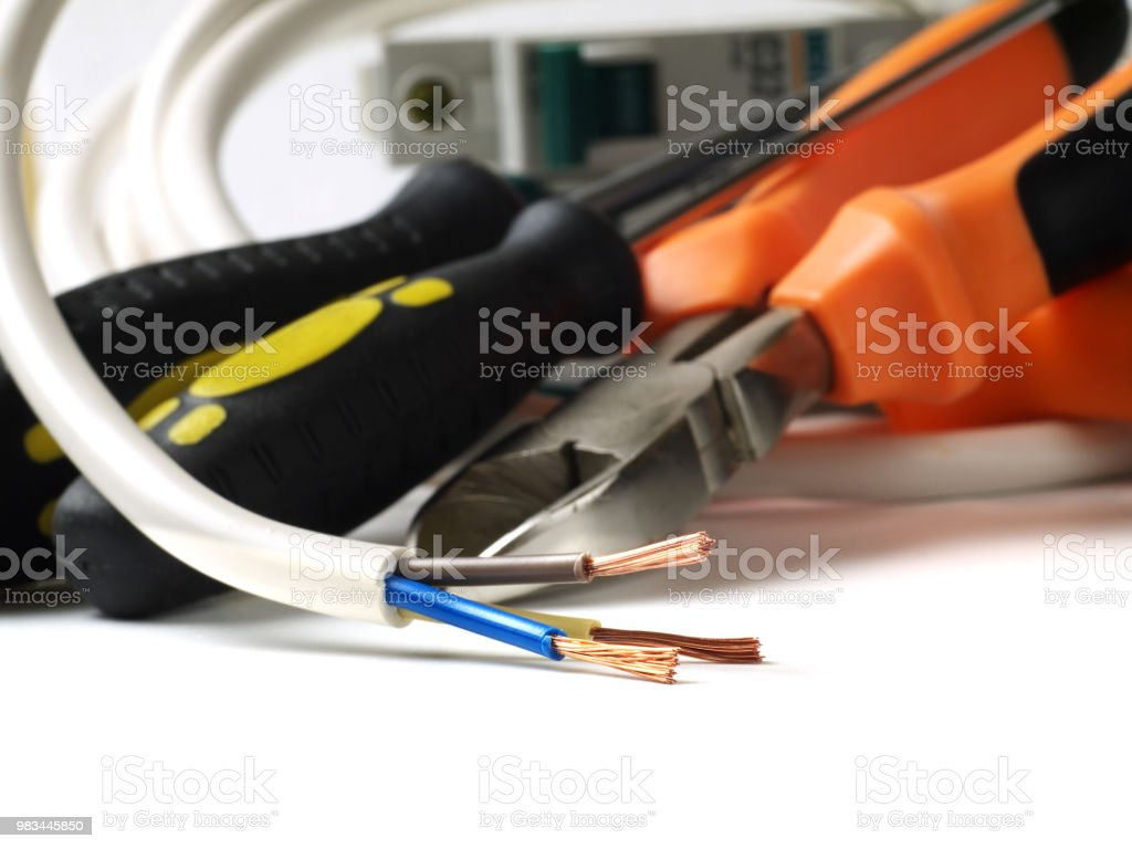 hight resolution of stripped wire in front of electric tools and equipment shallow depth of field royalty
