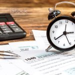 Tax Forms With Clock Pen And Calculator On The Office Wooden Table Top View Business And Tax Concept Stock Photo Download Image Now Istock