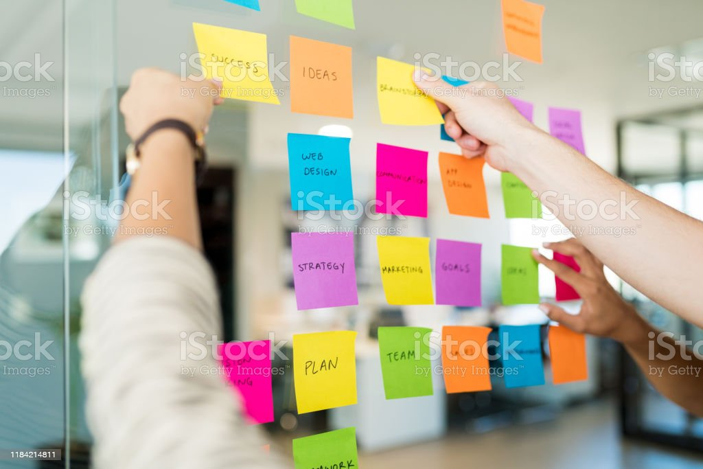 Team Planning Over Business Concepts In Meeting Stock Photo - Download Image Now - iStock