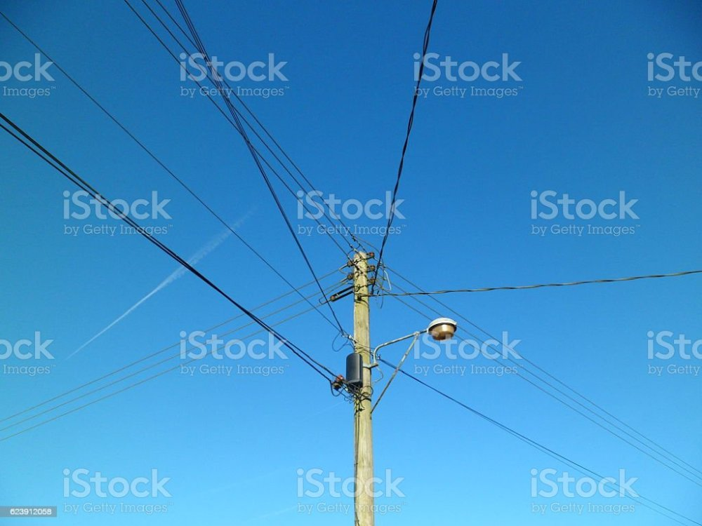 medium resolution of telegraph pole with telephone wires and street lamp royalty free stock photo