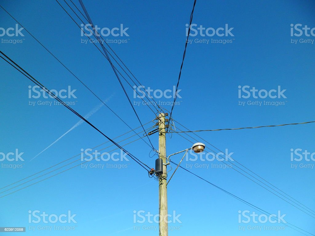 hight resolution of telegraph pole with telephone wires and street lamp royalty free stock photo