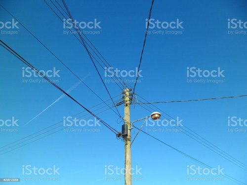 small resolution of telegraph pole with telephone wires and street lamp royalty free stock photo