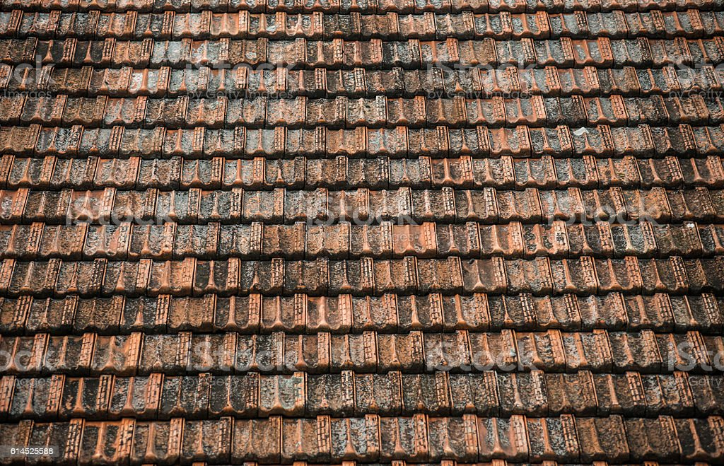 https www istockphoto com photo texture of old weathered red roof tiles gm614525588 106386753