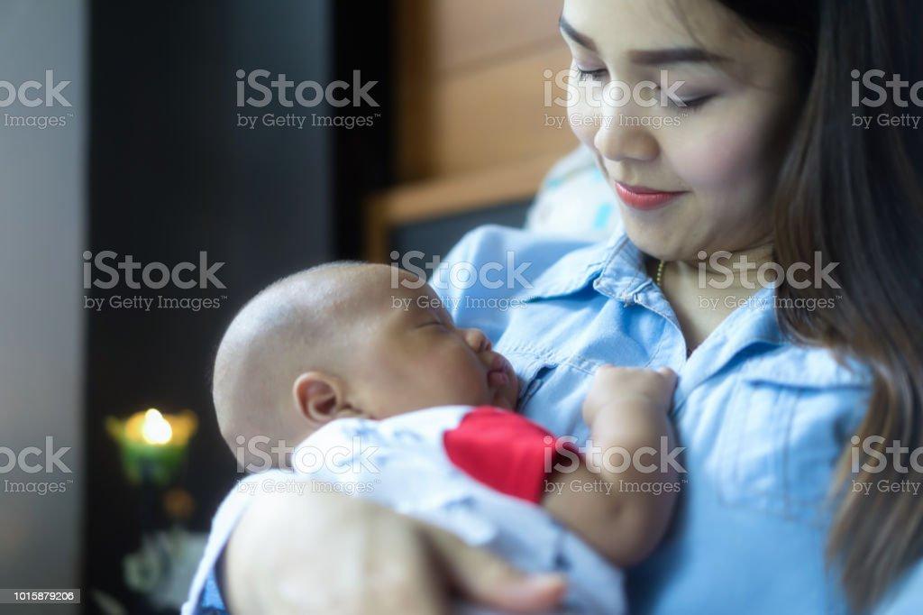 The Newborn Baby Sleeping On Mothers Chest Cosleeping ...