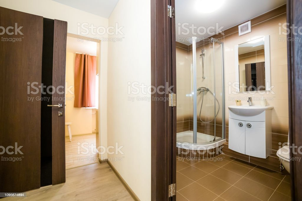The Photo Of The Light White Bathroom With Household Appliances Stock Photo Download Image Now Istock