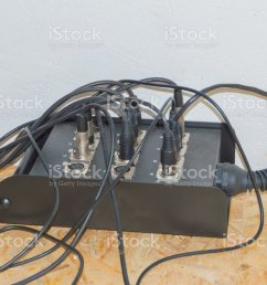 the wires from the musical instrument is plugged into an extension cord stock image  [ 1024 x 837 Pixel ]