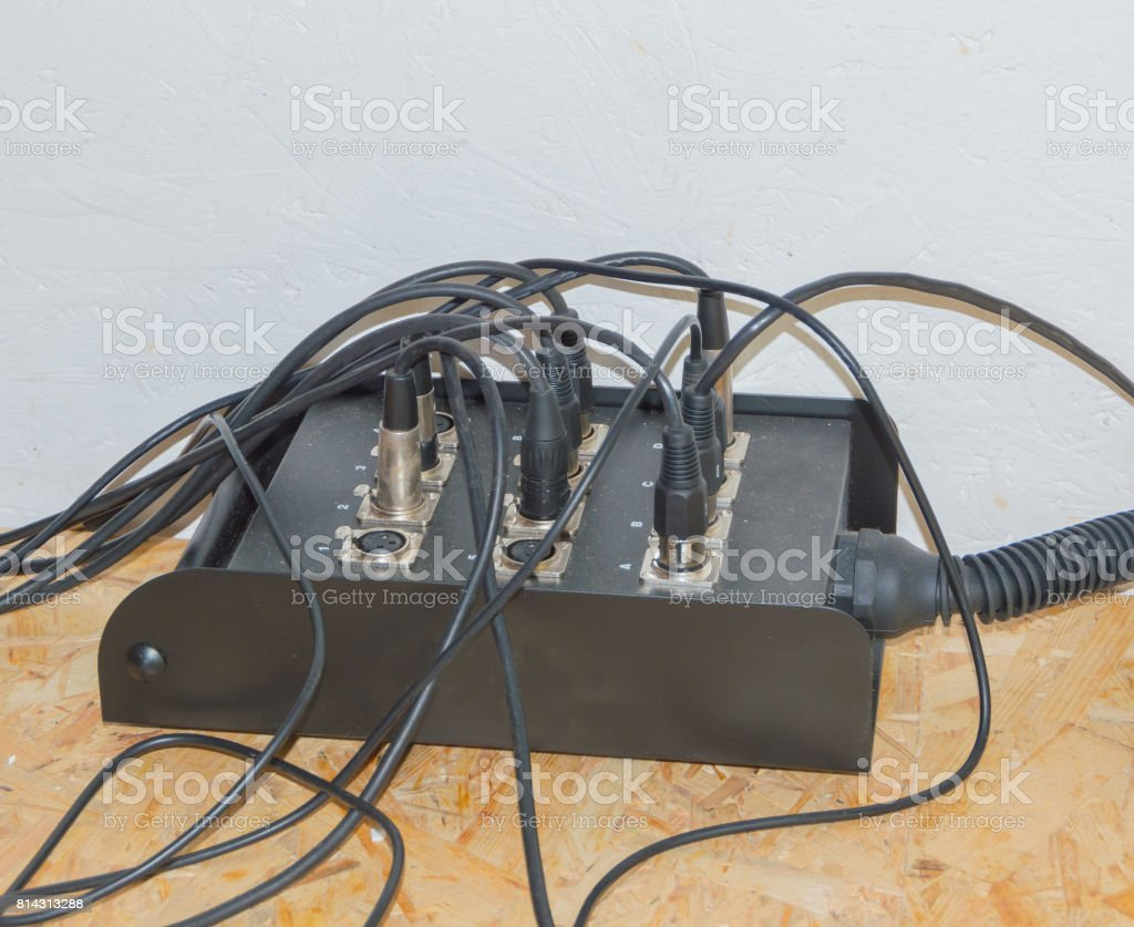 hight resolution of the wires from the musical instrument is plugged into an extension cord stock image
